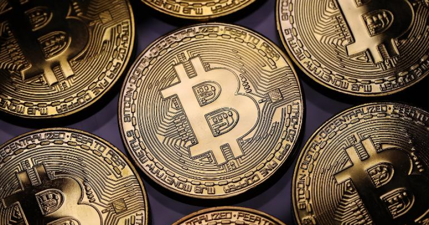 Bitcoin drops below $50,000 over tax hike scare