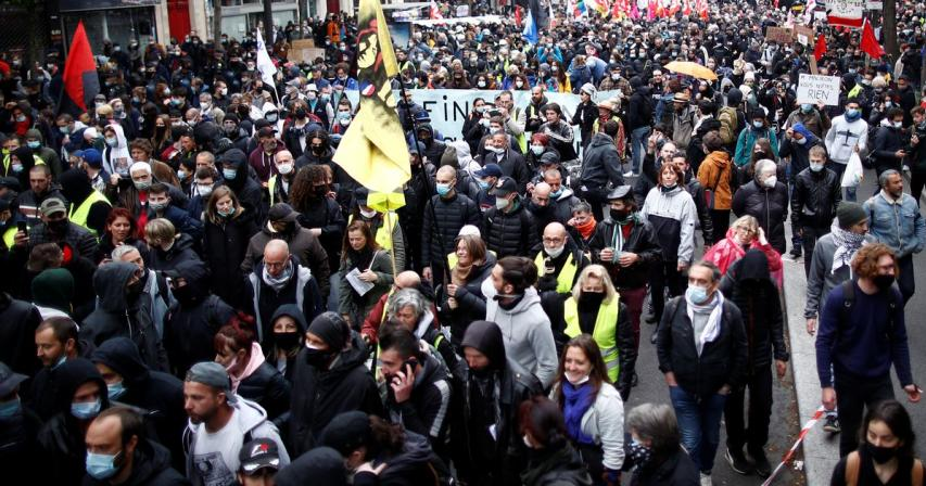 Protesters march in Paris and other French cities on May Day