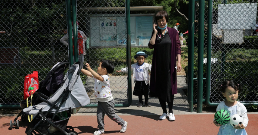 China's new three-child policy draws scepticism, cost questions