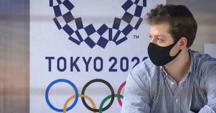 Japan may keep some virus curbs until Games start