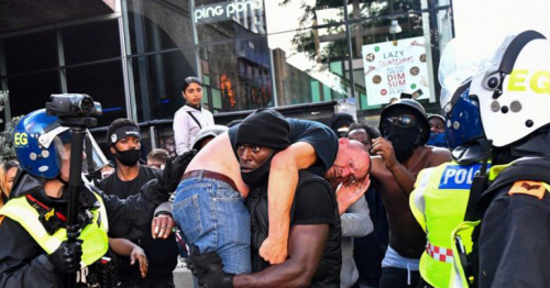 This powerful image of a Black man carrying a white counter-protester to safety frames a day of chaos and race-inspired violence in London