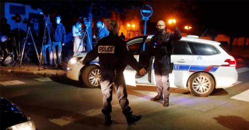 French police arrest nine after teacher beheaded in street