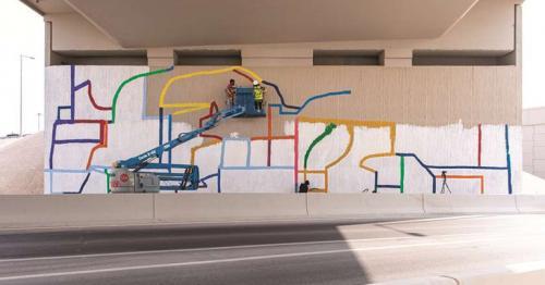 VCU-Q arts team paints huge 22-metre-wide visual treat on DFC interchange