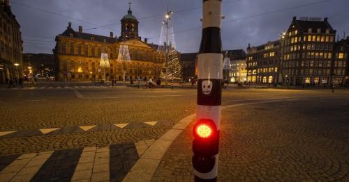 Dutch propose curfew to rein in virus; will ban more flights
