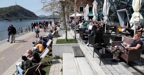 Budapest residents drink spritzer by the Danube as COVID rules ease