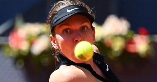 Halep knocked out of Madrid Open by Mertens