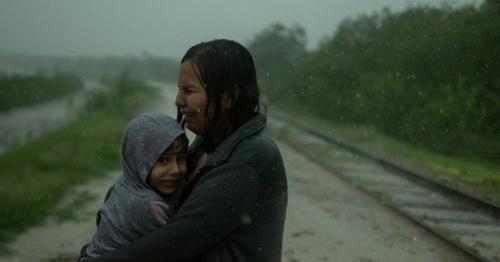 Rains drench migrants crossing Rio Grande river into United States